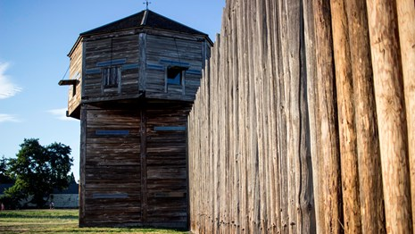 Photo of the bastion and wooden stockade at Fort Vancouver.