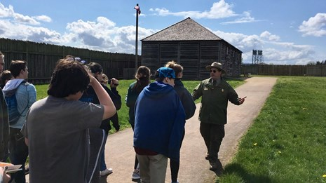 A park ranger leading a group of people through Fort Vancouver.