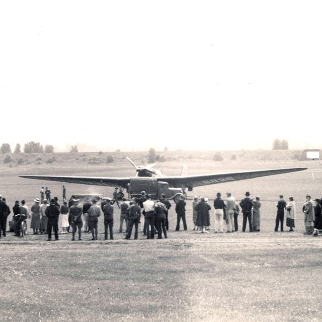 Historic photograph of ANT-25 aircraft landing at Pearson Field.