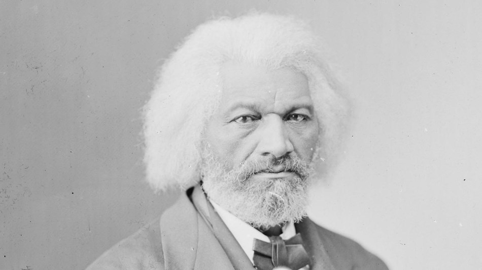 A black-and-white photograph of Frederick Douglass in his sixties