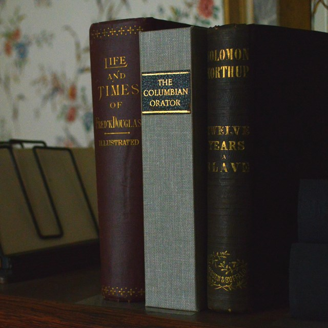 Three books on top of a desk