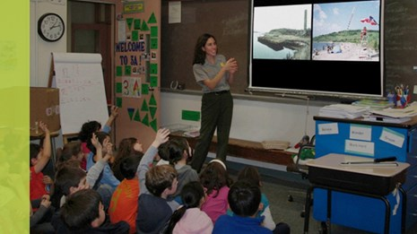 Ranger showing a slide show during a pre-visit to a classroom