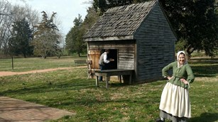 A historical interpreter posses for a picture on the Jon Dickinson Plantation.