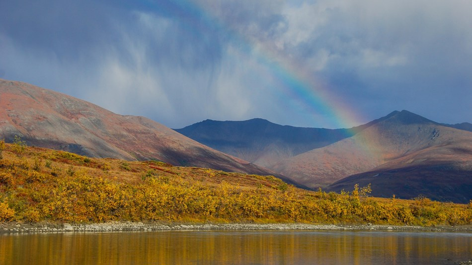 A rainbow over the Noatak River and mountains
