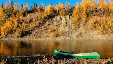 Canoe on shore along the bluffs above the Kobuk River
