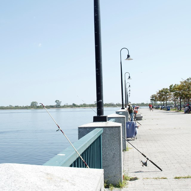 Fishing rods and light posts at Canarsie pier
