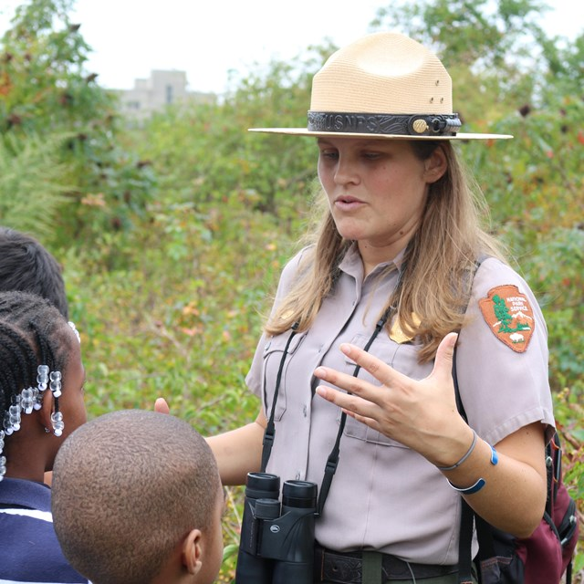 Ranger Erin outside with students