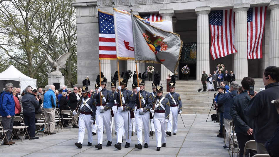 USMA West Point Cadets in full formal military uniforms carrying the colors (flags)