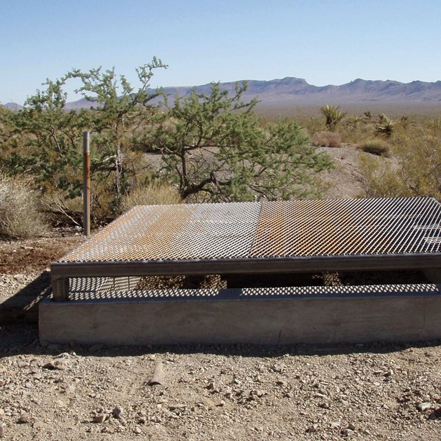 metal safety grate covering a mine shaft