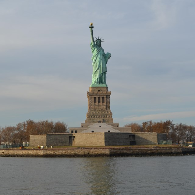 statue of liberty and liberty island's seawall