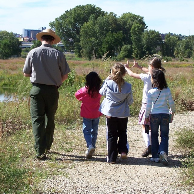 ranger walking with children