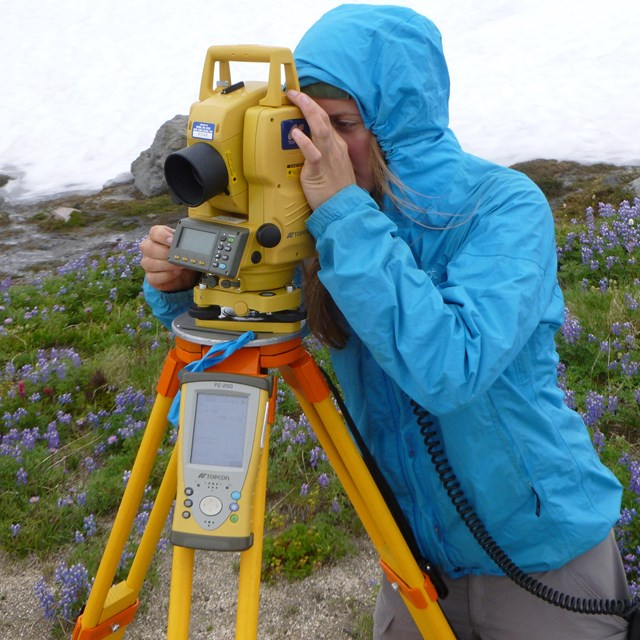 scientist using survey instrument