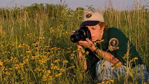 Volunteer photographing flowers
