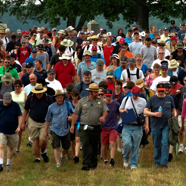 A park ranger leads a large group on one of the many ranger programs held throughout the year.