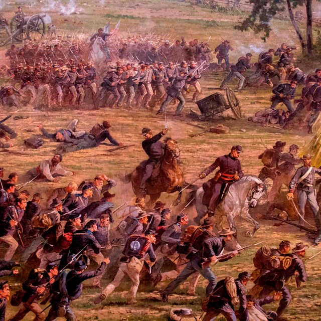 A scene from the Cyclorama painting depicting two Union officers on horseback leading their troops.