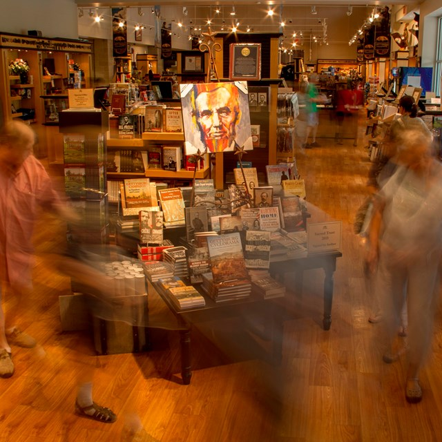 A view of the bookstore with visitors shopping and walking around.