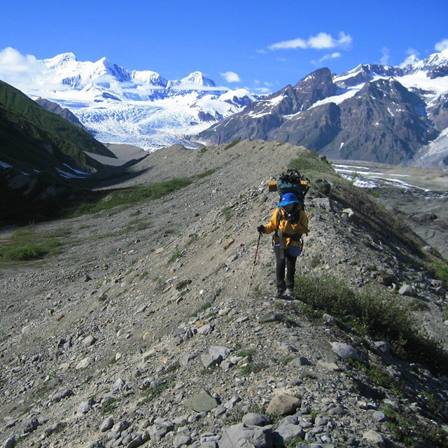 hiker on glacial moraine