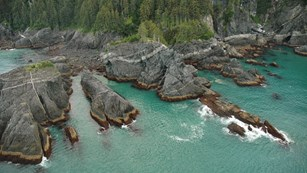 an aerial image of a rocky coastline