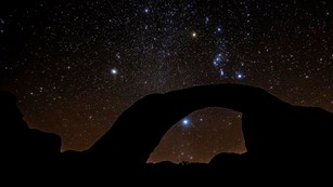 Night view of natural arch with starry sky