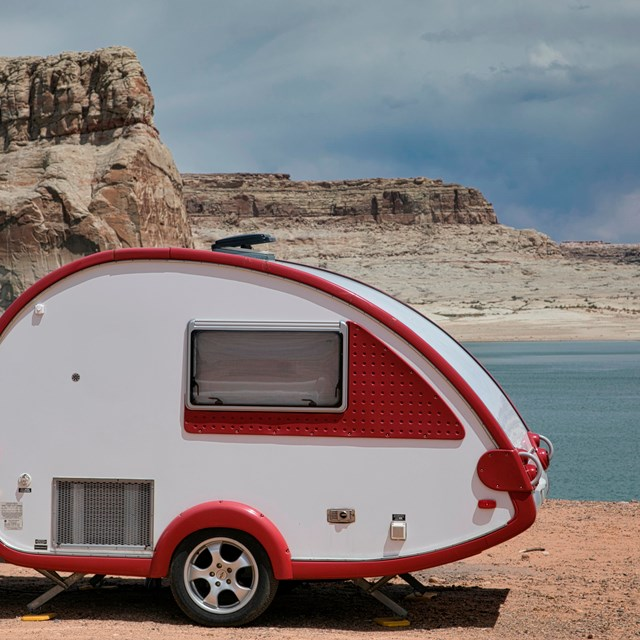 Teardrop camper parked on Lone Rock Beach