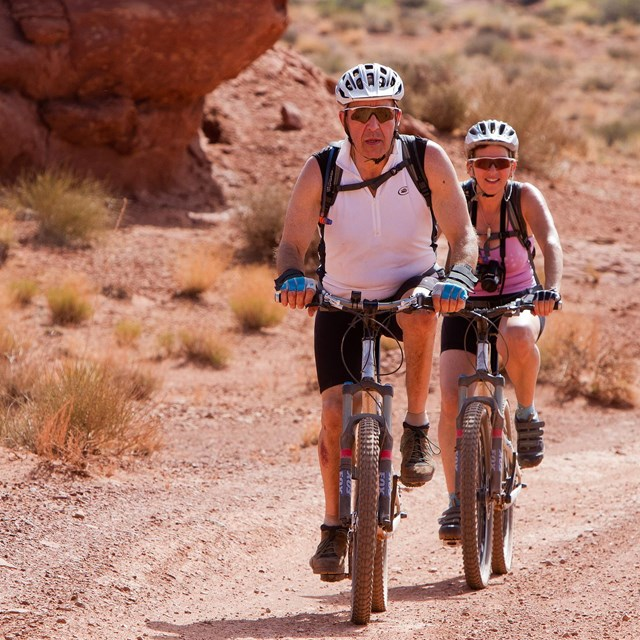 Pair of bikers on unpaved road