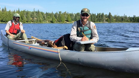 Two biologists in a canoe at Isle Royale National Park