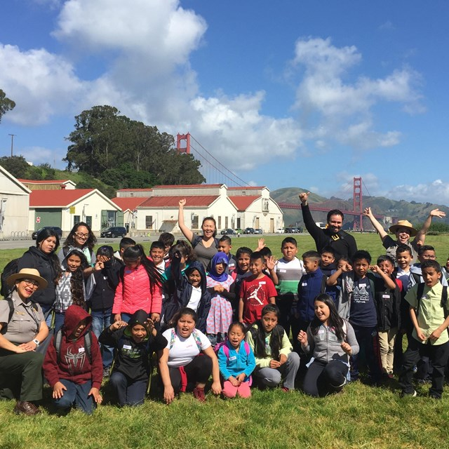 Ranger with community group pose together on Crissy Field