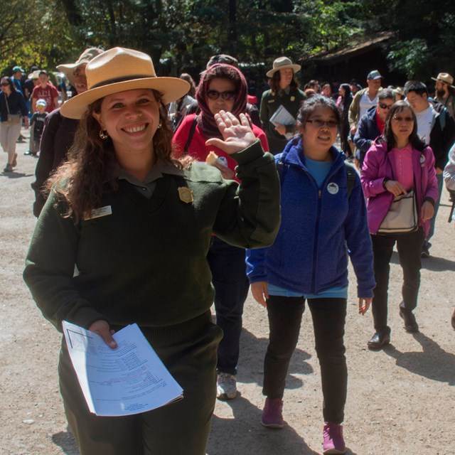 Ranger Jasmine guides a group into Muir Woods