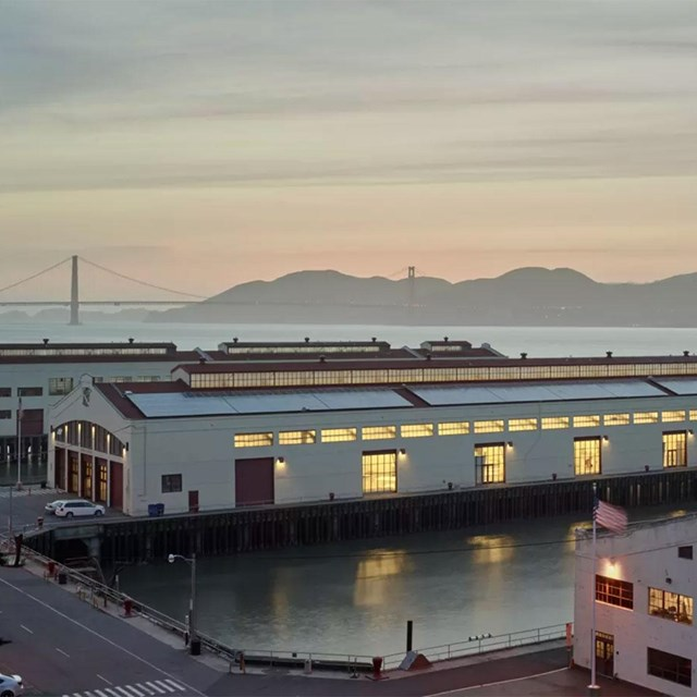sunset on golden gate bridge at fort mason center