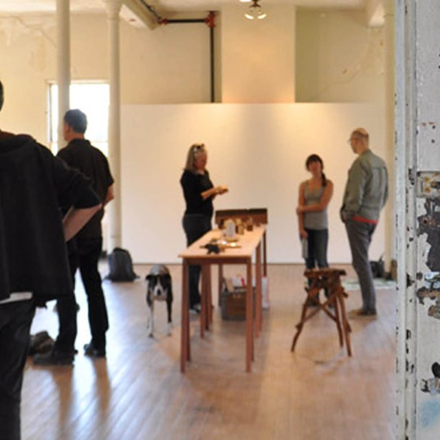 Artists and visitors mingle in the Headlands Center for the Arts
