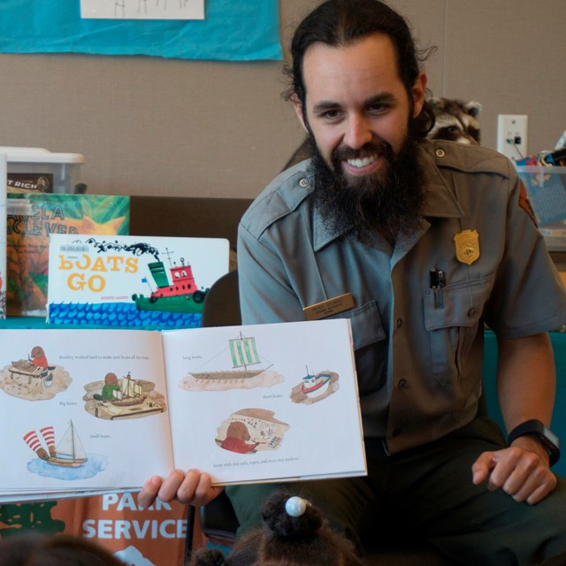 Ranger Rafael reads a story to children at a library.