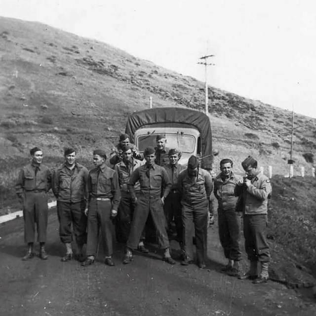 army men pose in front of truck at fort cronkhite