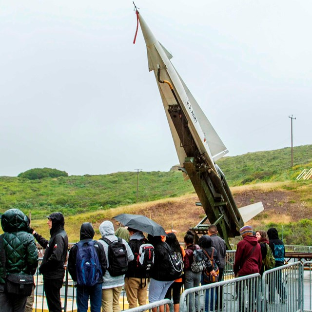 People lining up to see the nike missile