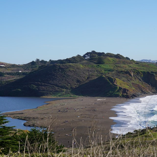View of Rodeo Beach, bordered by the Pacific Ocean on one side and Rodeo Lagoon on the other side.