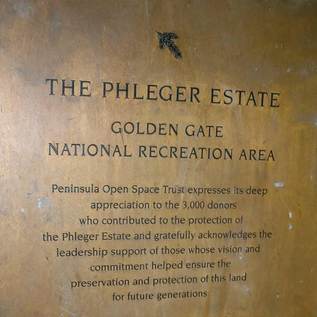 gold sign engraved with Phleger Estate