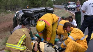 NPS employees working a rollover car accident.