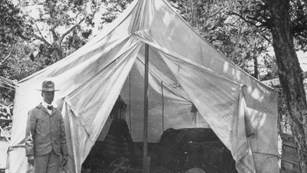 John Verkamp in front of his tent.