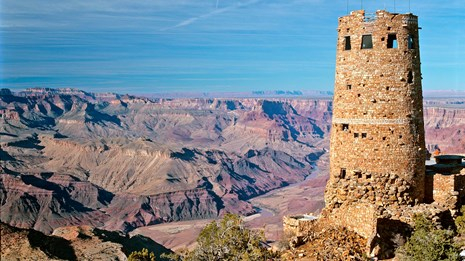 A stone tower on the edge of the Grand Canyon.