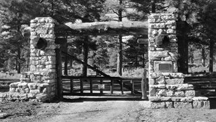 A black and white photo a the pioneer cemetery gate.