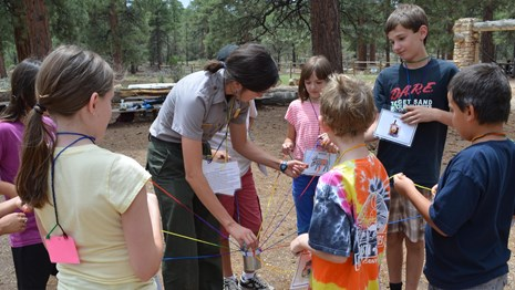 A ranger leads a hands-on activity with students.