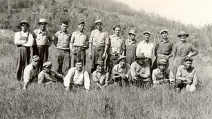 Black and White photo of two rows of men standing in a field