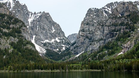 A mountain canyon across a lake.