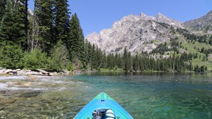 A lake and mountain as seen from the perspective of a kayaker