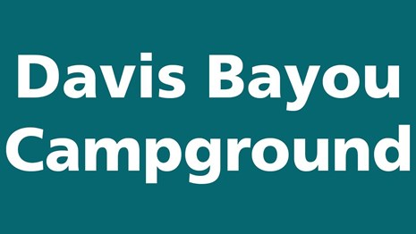 Davis Bayou Campground in white text on teal background.