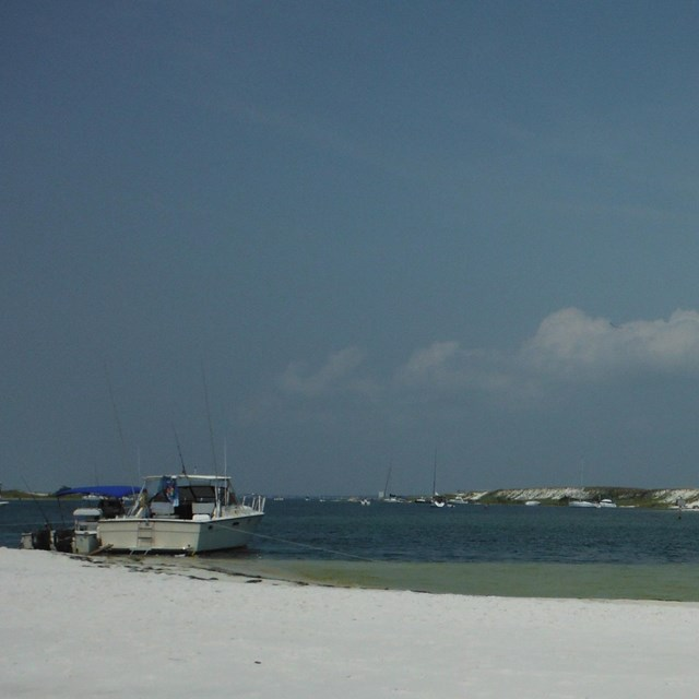 Boats beached along barrier islands.