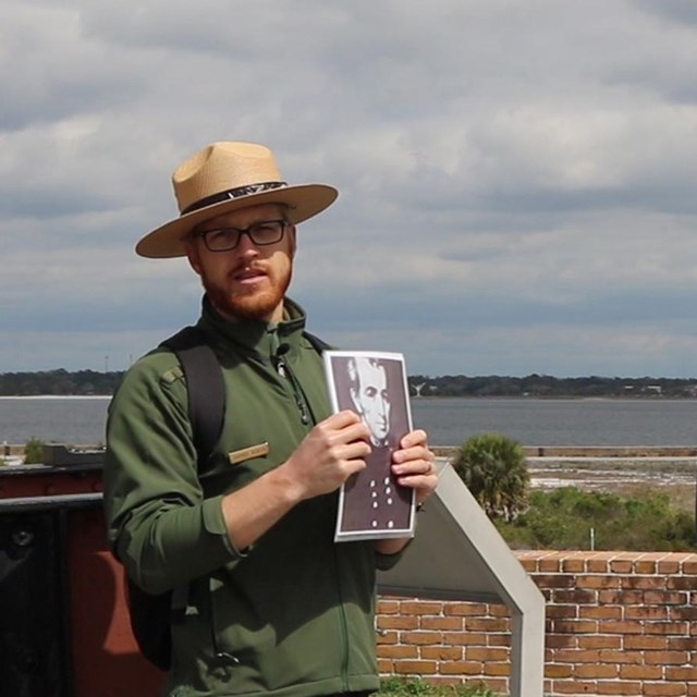 A ranger talks to visitors about park resources