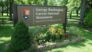 Entrance signs that reads George Washington Carver National Monument