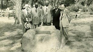 Five men gathered around at a memorial stone at the 1953 dedication of the park.
