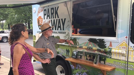 Park Ranger shows the Mobile Visitor Center to visitor.