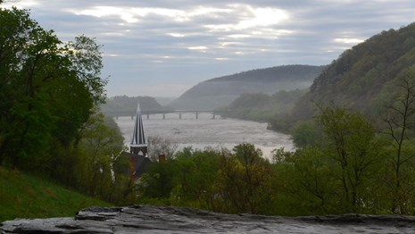 foggy view of the river and gap in the mountains from Jefferson Rock; church steeple is visible